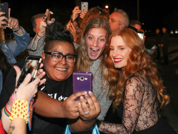 Jessica Chastain takes photos with fans during the
