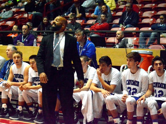 Carlsbad yells out to his players on the floor in the fourth quarter Wednesday at The Pit.