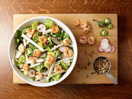 Mexican Caesar salad with jicama and grilled shrimp.