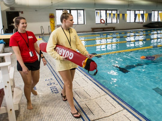 Lifeguards Madeline Snow, left, and Kathryn Fleming monitor swimmers at the Richard A. Henson YMCA on Wednesday, Jan. 24, 2018.