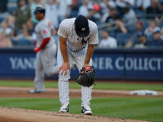 New York Yankees starting pitcher Sonny Gray reacts after giving up a solo home run to Boston Red Sox's Rafael Devers during the first inning of a baseball game, Saturday, June 30, 2018, in New York.