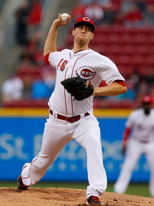 Cincinnati Reds starting pitcher Jon Moscot throws a pitch against the Chicago Cubs during the first inning at Great American Ball Park.