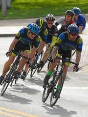 Racers travel around the Criterium course last year