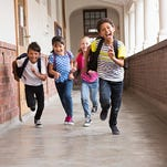 Students running down the hall