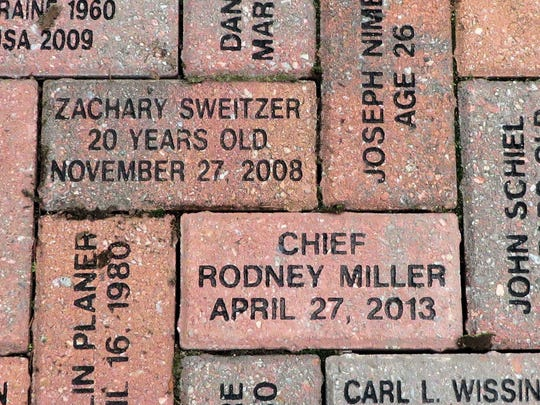 The names of Zachary Sweitzer and Rodney Miller, both killed by DUI drivers, are seen on bricks laid at the Memorial Garden in Harrisburg.