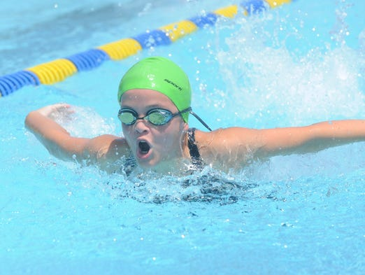 Mountain Home Hurricanes swimmer Madelyn Lynch competes in a butterfly event Saturday at a meet at Cooper Park.