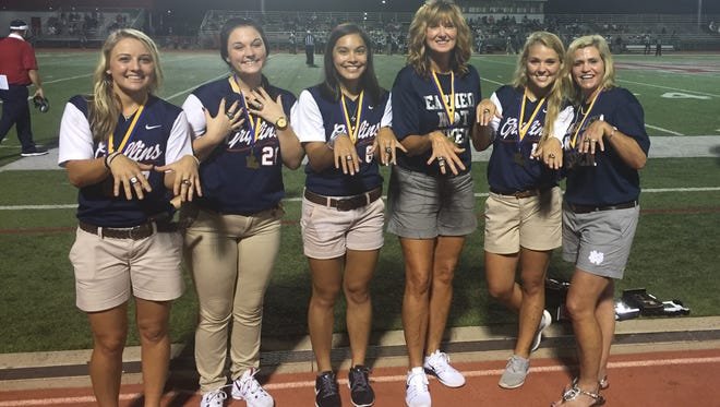 North DeSoto seniors Emily Henderson, Stephanie Easter, Lea Posey, coach Lori McFerren, Sami Walters and assistant coach Julie Henderson display their softball state championship rings