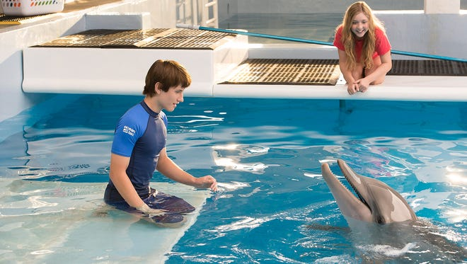 More 'Tale' to be told: Winter the dolphin, Nathan Gamble, left, and Cozi Zuehlsdorff return for 'Dolphin Tale 2.'
