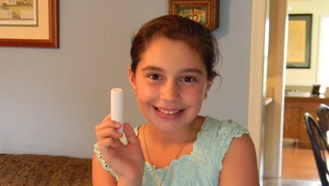 Grace Karaffa, 11, a fifth-grader at Stuarts Draft Elementary School, holds up a stick of lip balm that she would like to be able to carry to school. Augusta County (Va.) Public Schools ban lip balm for sanitation reasons.