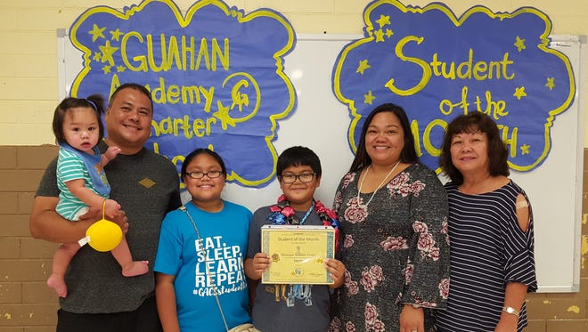 The Guahan Academy Charter School honored its March Student of the Month awardees on April 12, 2018. Pictured from left: Kenneth Cruz with his baby Kenoa Sablan-Cruz; Ciana'lyn Sablan-Cruz; Josett Cruz and Teresita Cruz,Dean of High School Guahan Academy Charter School.