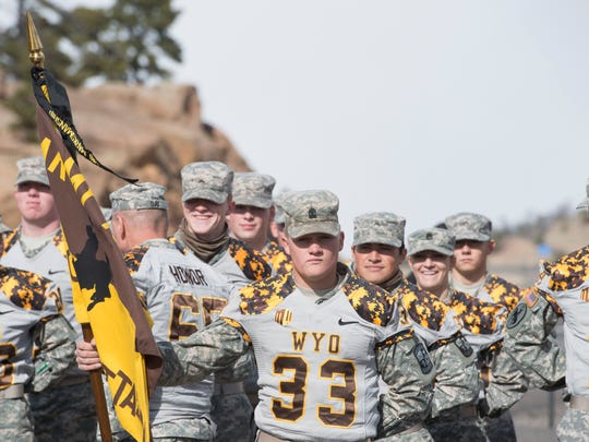 Wyoming ROTC cadets wait at the Colorado and Wyoming border to receive the game ball and continue a relay to Laramie, Wyo., before the 2015 football game between the Border War rivals.