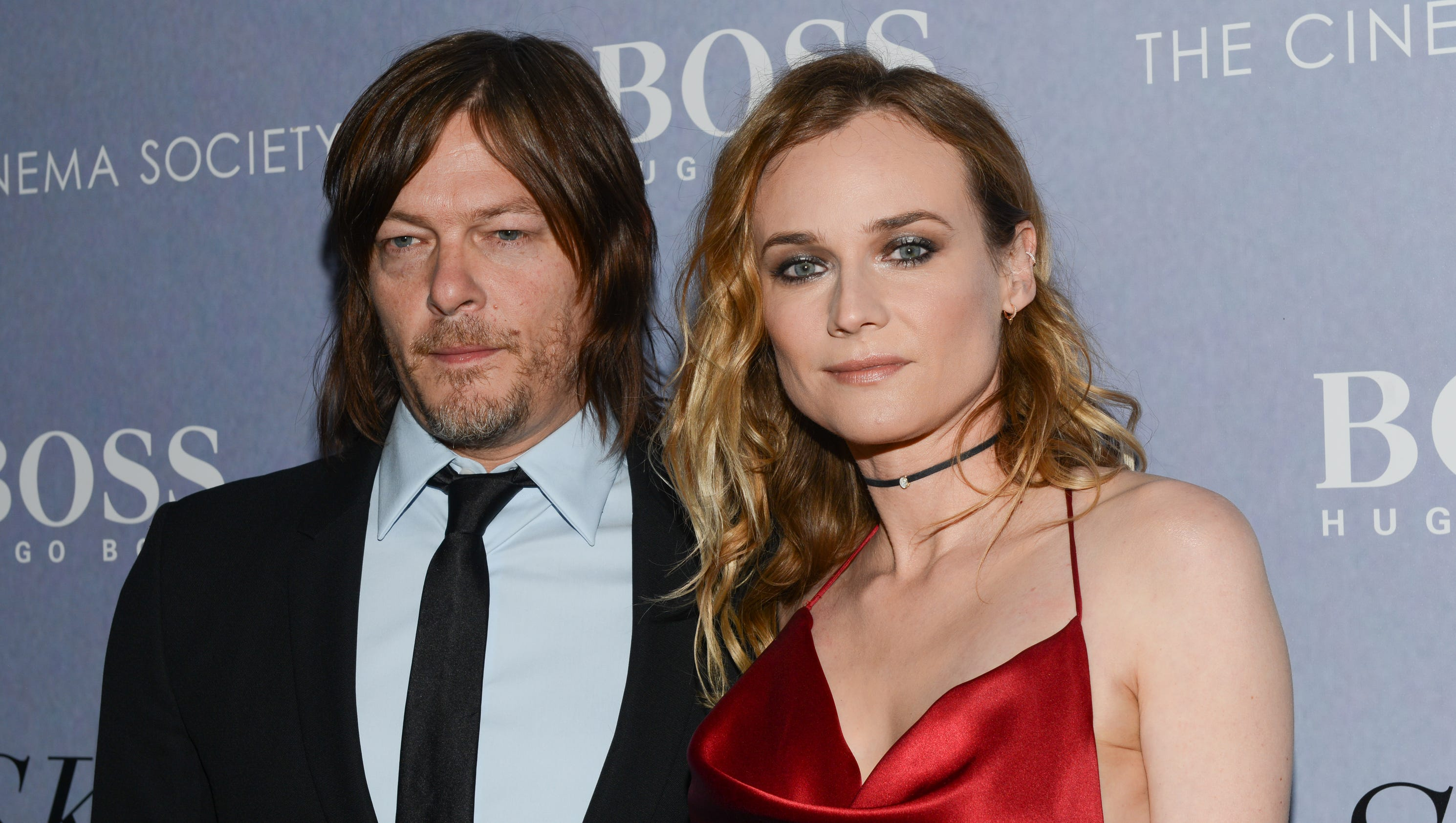 Norman Reedus and Diane Kruger pack on PDA amid dating rumors