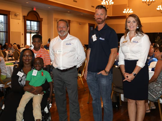 Habitat Homeowner in Process Passion Burgess, left, and Elijah and Frederick Burgess, with Doug Miller, Jeff Deans and Lindsey Concannon at the Building Hope Breakfast on Nov. 8. Miller, president of St. Lucie Battery & Tire, has committed to sponsor Burgess' Habitat house.