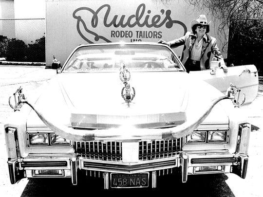 Nudie Cohn in his car.