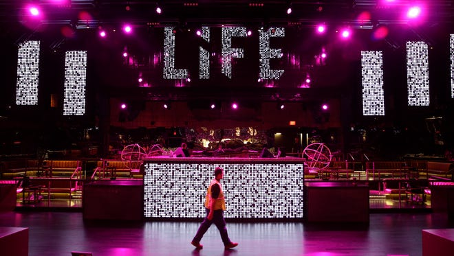 In this photo taken on Aug. 20, 2014, a man walks through the Life Nightclub in the SLS Las Vegas in Las Vegas. The hotel and casino, formally known as the Sahara, has gone through extensive renovations is scheduled to open this weekend.