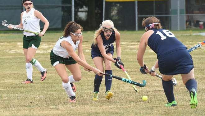 Spackenkill's Cassidy Gent, left, and Pine Plains' Cortney Conley, center, and Cat Simmons, right, fight over the ball during Monday's game.