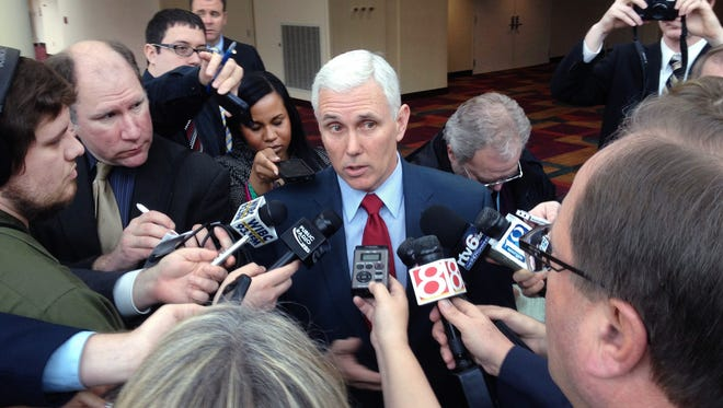Reporters interview Gov. Mike Pence.
