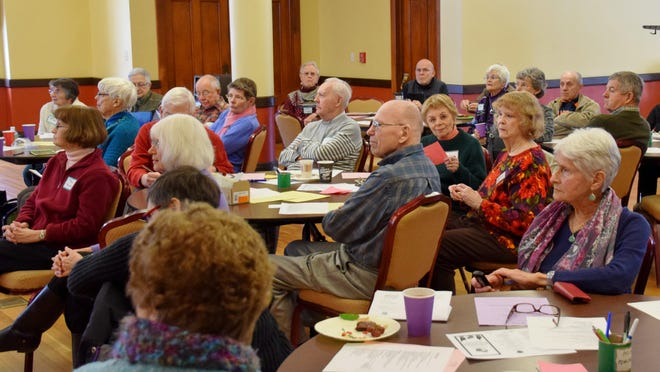 Members of HLAA listen to a speaker during a regular monthly meeting.