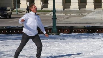 Sen. Jeff Flake faced-off against Sen. Cory Booker in a snowball fight Wednesday morning. Pictures of the duel were posted to Twitter.