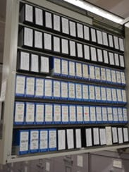 Rolls of microfilmed newspapers fill a drawer at the