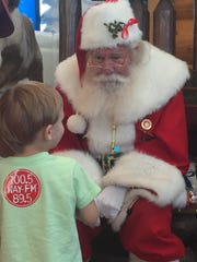 Santa (Paul Kudla) hears Christmas wishes at Bass Pro Shops in San Carlos Park.
