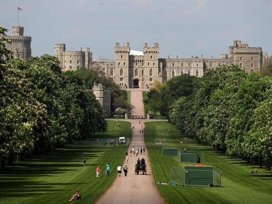 People walk along the Long Walk leading up to Windsor Castle in Windsor, west of London.