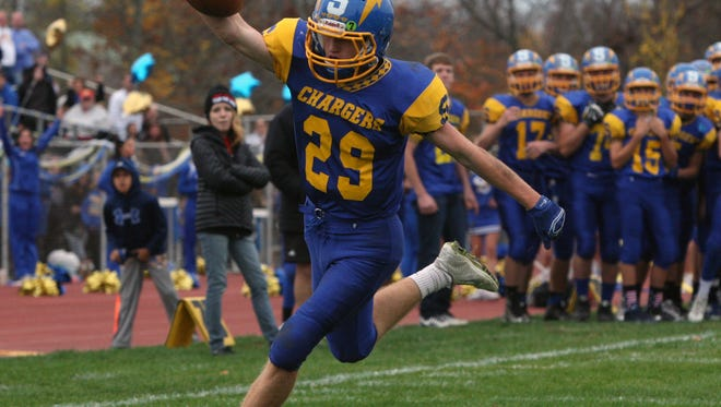 Metuchen at Spotswood football and the winner of this game will be GMC Blue Division Champions on Saturday November 7, 2015.Spotswood's # 29 Jack Keenan celebrates as he heads into the end zone for a 1st half touchdown.