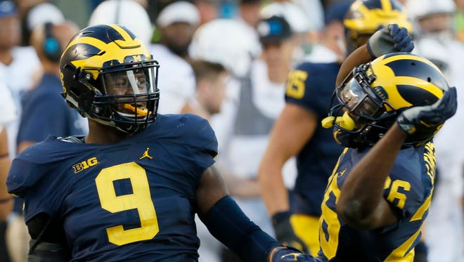 Michigan linebacker Mike McCray celebrates his interception in the fourth quarter with teammate Jourdan Lewis in their game against Penn State at Michigan Stadium in Ann Arbor on Saturday, September 24, 2016.