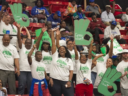 Fort Myers High School fans cheer on their team as