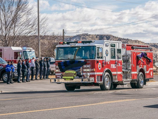 A funeral procession for Farmington Fire Department Lt. Jacob Shadd Rohwer, 44, traveled down Main Street on the way to his funeral service in the Henderson Fine Arts Center at San Juan College on Sunday.