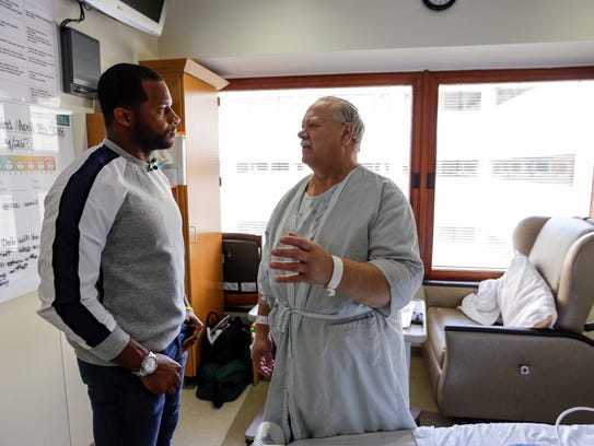Randall Cobb visits with James Fraser of Green Bay