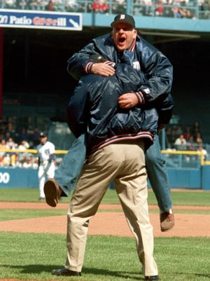 Mickey Lolich reenacts his 1968 World Series celebration with Bill Freehan, after the two took part in the ceremonial first pitch in the Tigers opener against Tampa Bay on April 7, 1998 at Tiger Stadium.