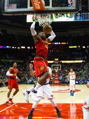 Atlanta Hawks forward Paul Millsap (4) dunks in the first half of an NBA basketball game against the New York Knicks on Sunday, Jan. 29, 2017, in Atlanta.