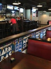 Fully Stacked Bar & Grill is located in the Red River Entertainment District under the Texas Street Bridge.