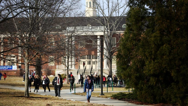 Students walk near the College of Engineering and Computing on Miami University's campus on February 18.