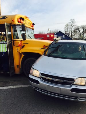 A Muncie school bus collided with a van traveling the wrong way down Elm Street on Monday morning.