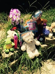 A collection of toys, flowers, balloons and candles