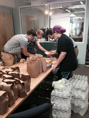 United Way staff members prepare meals for Lunches for Hope.