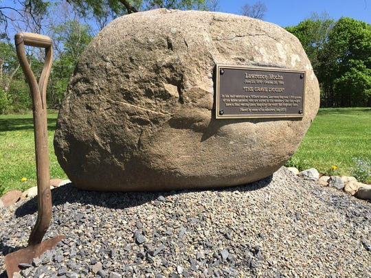 The memorial to Lawrence Mocha credits him with digging
