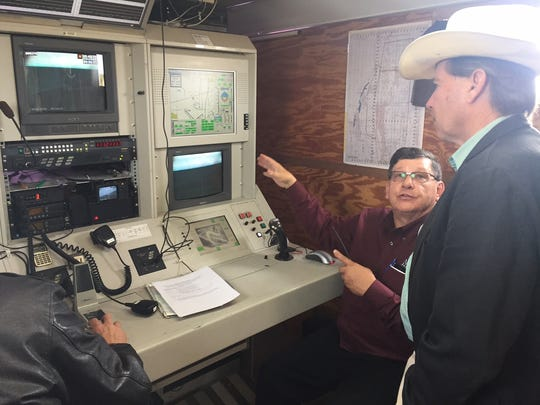 "Dennis ""Zak"" Zaklan, deputy director of New Mexico State University's Unmanned Aircraft Systems Flight Test Facility, shows Sen. Tom Udall, D-Santa Fe, the instrumentation inside a mobile control room at the Las Cruces International Airport during a test flight Tuesday, Nov. 1, 2016."