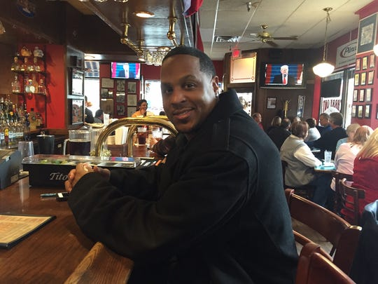 Elvis Brown, Trump supporter, at Loughmiller's Pub during the inauguration. He was one of the few patrons paying attention to the history unfolding on the TV.