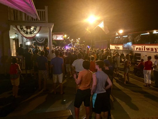 A crowd gathers in front of The Livonia Inn on Commercial Street in Livonia to celebrate the baseball team's return after the Bulldogs won the Class B state baseball title on June 10, 2017.
