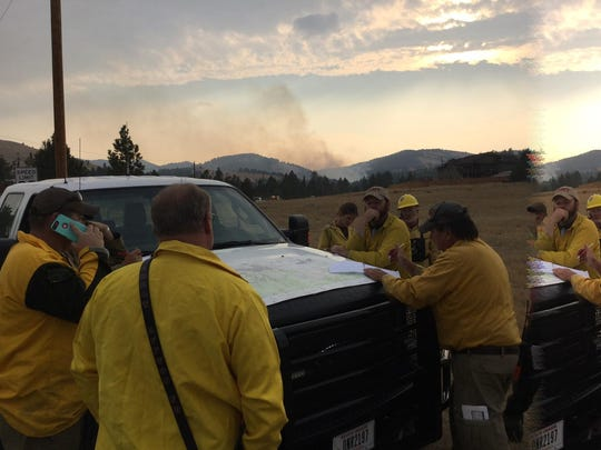 Firefighters at the Homes Gulch fire Thursday evening.