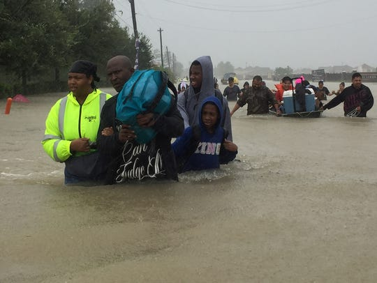 Volunteer rescue residents from flooding from Tropical