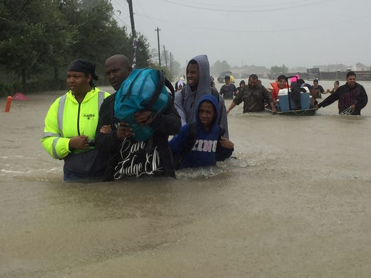 Volunteer rescue residents from flooding from Tropical Storm Harvey.