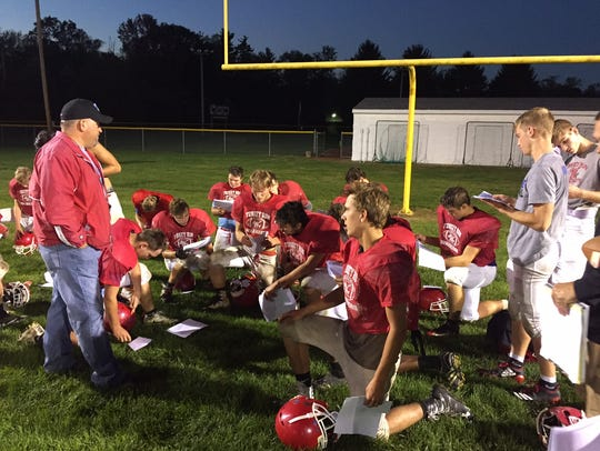 Bruce Scaggs (left) addresses the Turkey Run football team.