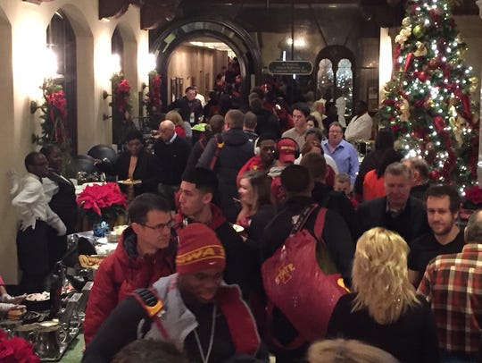 The Iowa State football family amid folks at the Peabody