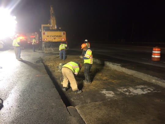 Delaware Department of Transportation crews work to repair a pothole, closing two lanes of I-95 North between the Newark toll plaza and DE-896.
