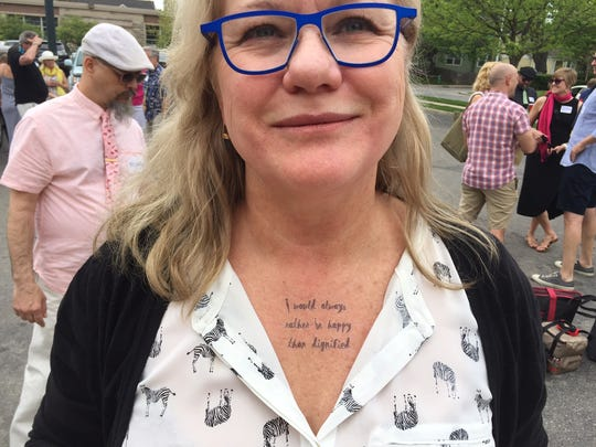 """Audrey Krause, winner of the neckwear award, with this fake but real-looking tattoo: """"I would always rather be happy than dignified."""""""