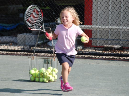 Ashley Heinrich radiates the joy of the tennis session.